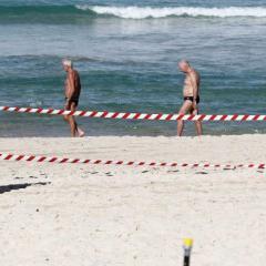 men on a beach