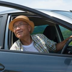 elderly man in a car