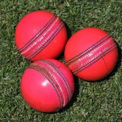 three pink cricket balls