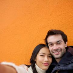 young interracial couple taking a selfie