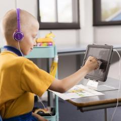 child doing speech pathology via telepractice