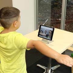 boy doing telerehabilitation