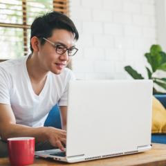 Asian man on laptop