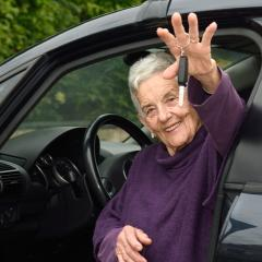 older woman in car