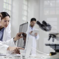 pharmacists looking at a computer screen